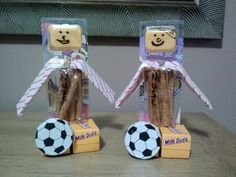Soccer snack, soccer player: mini milk duds for feet, chocolate soccer ball, pretzel cheese dippers for body & head, sticks of gum for arms. :-)