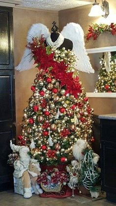 angel wings and a crown are an interesting decorative touch to this dress form christmas tree - Christmas Tree Dress