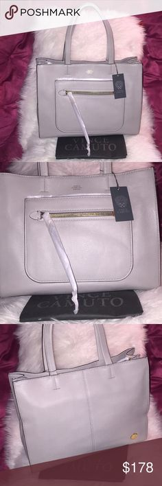 """💞👜Vince Camuto large leather tote purse👜💞 Send me best offer. Brand new. Guarantee 100% authentic by VC. Soft genuine leather. Fully function. Perfect buddy for your daily go-errand. Triple compartment. Dual leather handle, approx. 9"""" drop length. Middle zip top closure. Interior one padded tech snapped pocket along with zip pocket and 2 slide pockets. Tech padded pocket approx. H8"""" x L11.5"""". Notebook fit. Exterior has one front slide pocket, along with zip pocket. Dust bag included…"""