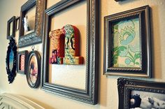 3D Wall art -- framed initial surrounded by pictures and other art. I'm obsessed with this!!!! Especially that letter!