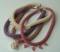 Bead Crochet Ropes ~ leads to a flicker pic... this link leads to video showing how to do it.... http://www.dailymotion.com/video/xs6qmz_how-to-bead-crochet_creation#.USOKvh04tRU