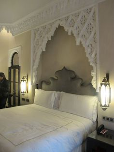 Lovely Moroccan headboard with side lanterns. #Lanterns #Moroccan #Headboard.