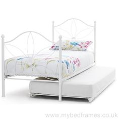 White metal #guest #bed with daisy pattern from mybedframes.co.uk