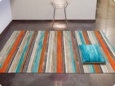 Yes, it's a rug, but it could be a quilt. Love teal and orange.