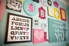 what a beautiful wall this would make in a nursery! roundup prints and photos in bright colors and build your room around that!     London's Big Girl Room - modern - kids - other metro - Ginny Phillips