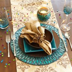 New Year';s Eve - Blue, Gold and Brown Place Settings from Pier1.com . These are great for people going for the beautiful blue/brown Christmas theme this year!