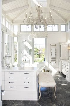 "French country design often incorporates ruffles, distressed woodwork and soft, patterned fabrics. Using some of these ideas, the home owner aimed at a laid-back feeling and a ""farmhouse look""."