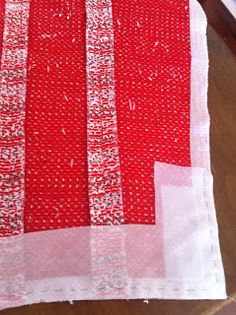 Cut interlining from muslin on the bias and tack to bottom of sleeve.