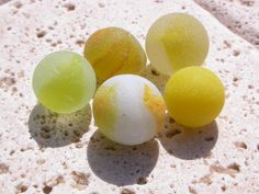 Rare yellow sea glass marbles that we collected from the beaches of Puerto Rico www.naturalseaglass.com