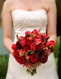 Red bouquet with different types of flowers