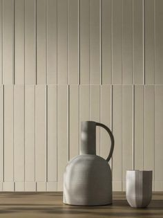 This contemporary dining room has two textured porcelain wall tiles from the Segments Collection. This material is great for indoor and outdoor use and there are many colors and styles available. Terrazzo, Wall Tiles Design, Exterior Cladding, Wall Installation, Milan Design, Interior Walls, Interior Design, Simple Lines, A Table