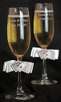 This fun Las Vegas wedding toasting glasses set features a royal flush of hearts and a satin bow. Glasses made of crystal.  ****IF YOU SELECT