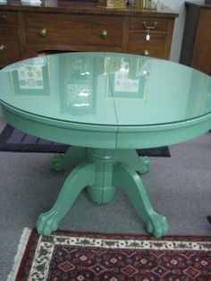"""Round claw foot oak dining table with green painted finish, 44"""" diameter, with protective glass top"""