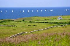 Looking across the Lewis Farm at sailboats on the Atlantic. Block Island  is 13 miles off the Rhode Island coast and 14 miles from the easte...