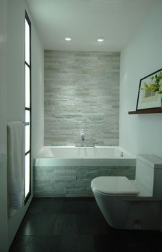 27 Absolutely Gorgeous Bathroom Design Ideas With Brick Walls Beautiful Small Bathroom Tile Ideas to Enhance Interior Quality: Fantastic Bathroom Design With White Tub Grey Tile Wall White Toilet White … Small Bathroom Tiles, Modern Bathroom Design, Contemporary Bathrooms, Bathroom Interior, Cozy Bathroom, White Bathrooms, Bathroom Fixtures, Master Bathroom, Bathroom Grey