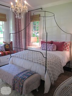 bed + chandelier + mixed patterns + colors | Amber Interior Design