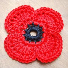 Crochet Flower Patterns Crochet remembrance poppy … - Get those hooks out. here's a free Remembrance Poppy Crochet Pattern. Poppy Crochet, Crochet Poppy Free Pattern, Crochet Puff Flower, Crochet Flower Patterns, Crochet Flowers, Knitting Patterns, Crochet Simple, Love Crochet, Crochet Gifts