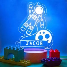 Gift the magic and wonder of space with this completely unique astronaut night-light, with choice of 7 ambient light colours and personalised with a name.  TO PERSONALISE THIS ORDER: Please let us know the details you would like in the note section at the note section for the checkout - for example: Name: Jacob  Add a comforting light to a niece, brother or new babys room with this magical, space themed night light. Inspire them to reach for the stars and fall asleep dreaming of…