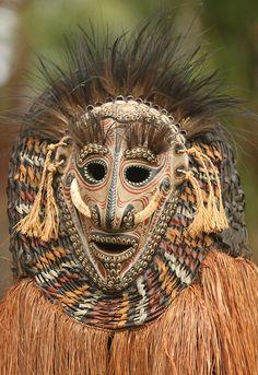Wearing a dancers mask Papua New...
