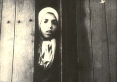 Westerbork, Holland. Settela Steinbach staring out of a deportation train, May 19,1944.  The deportation on this date was of [Roma/Sinti] from Holland. Settela Steinbach, was born in Limburg, Holland and died in Auschwitz, Poland on the night between August 2 and August 3 of 1944 along with her mother and her 9 brothers and sisters.
