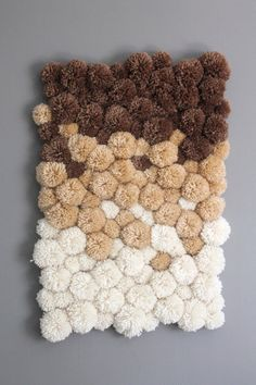 This gorgeous ombre pom pom rug is the perfect addition to a powder room or babys room. It can also be used as eye-catching wall decor!  Ivory, tan, and taupe pom poms are individually handmade with soft acrylic yarn. Over 120 pom poms (made in two sizes) are attached to a sturdy rug canvas in an organic pattern, giving it a natural feel.  Approximately 17 x 24  CARE:  Due to the handmade nature of the pom poms, this rug cannot be machine washed or dry-cleaned. Spot clean only. DO NOT…