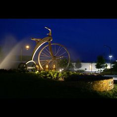 """Chasing the Wind"" Functional 10 foot tricycle, steel and bronze. Photo by Lee Capps Photography."