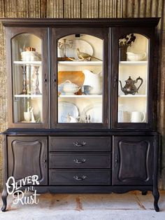 Oliver and Rust || general finishes lamp black china cabinet with annie sloan white mix interior