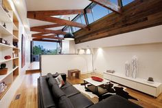Richmond Warehouse Conversion - industrial living room. Wooden beams, windows and roof shape