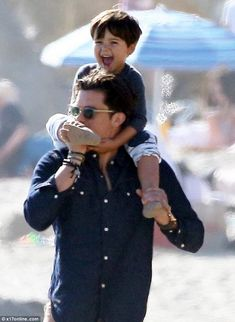 Happy: Flynn, Orlando's son from his marriage to Miranda Kerr, appeared to be having a wha...