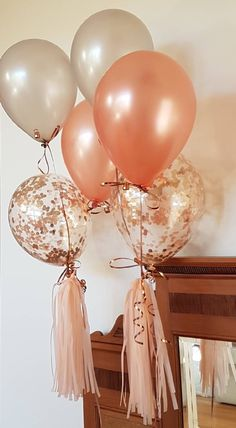 Peach tassels complete the balloon bouquets