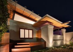 """The Queens Park Residence in Sydney, Australia, designed and built by Australian architects CplusC Architects and Builders, is based on the idea of """"good wood."""" Displaying the firm's love of wood and how it inspires a warm flavor of architecture, this timber home design welcomes residents and guests with an entry sequence leading to a recycled Jarrah door."""