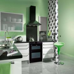 Delightful Green Color Theme Kitchens From Sports Car Makers With L Shaped White Base Cabinet That Have Round Shaped Sink Complete With The Faucet Also Elegant Black Oven That Have Black Stove Appliance Best Collections Kitchen From Sports Car Makers Kitchen