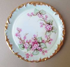 1910 An antique Edwardian 1910 era hand painted T & V Limoges France 7 inch diameter serving plate with hand painted cherry blossoms or maybe apple blossoms and foliage on a pale celadon green background and a deep gold gilt rim, marked on the back side as shown, all in most excellent condition with no chips, cracks, crazing, wear or damage of any kind, a lovely antique serving or accent piece for your home or to give as a gift.  All items guaranteed to be vintage.