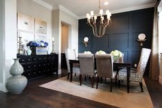 Wallpaper, mixed 'n matched chairs, a perfectly proportioned rug and gorgeous accessories. Dining Room by Stiles Fischer.