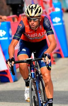BahrainMerida's Italian Cyclist Vicenzo Nibali crosses the finish line at the end of the 14th stage of the 72nd edition of 'La Vuelta' Tour of Spain...