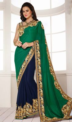 Designer jade green and navy blue embroidered half n half sari is planned on georgette and chiffon fabric. The sari is foliage inspired motifs which is garnished with woven lace, silk thread foliage embroidery on velvet applique and crystal stones which adds charm and grace to your beauty. The sari comes with contrast beige and navy blue brocade stitched blouse as shown in the picture. #StunningLookTrendsetterSaree