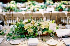 Rustic chic organic green and white centerpieces with orchids, anemones, dahlias, chestnuts and olives in wood box on long wedding table. Design by Waterlily Pond Studio www.waterlilypond.... Holman Ranch Vineyard and Winery in Carmel Valley. Tanja Lippert Photography