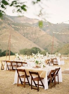 HappyWedd.com Setting up a dance floor and tables with string lights in an open field would be perfect!