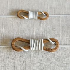 Oak cord wrap by Naoto Yoshida. I have cord OCD, and this is a pretty classy solution. $20.00