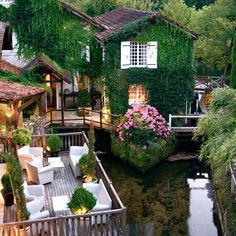 Le Moulin du Roc Hotel, France.  Twist it up....think of a home inspired by this hotel with this type of easy going outdoor space