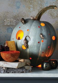 Martha updates her Mouse Motel this year by using a beautiful gray pumpkin. Round holes and rubber mice are all you need for this look!