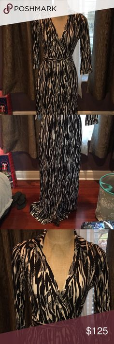 Diane Von Furstenberg Wrap Dress Size 8 NWT Brand new with tag, size 8 - would fit a medium, style name is Abigail, maxi dress, wrap dress is the style, black and white pattern Diane Von Furstenberg Dresses Maxi