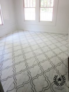 She achieved this beautiful design by stenciling her floor with Annie Sloan Chalk Paint in Paris Grey. Instead of using a polyurethane or lacquer to seal the paint, she lightly sanded her floors and then waxed them with floor wax, which will allow the floors to age naturally and become distressed over time.