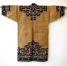 Japanese Ainu Robe, Woven Elm Bark. Japanese traditional tribal robe worn by the Ainu people of Northern Japan, woven out of fine strips of elm bark with wide strips of dark indigo cotton cloth and chain stitch embroidery, minor wear, circa 1920's. Length: 50 inches.