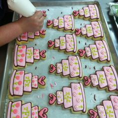 Putting the finishing touches on a wedding order.   Pink wedding cakes. by bundlesofcookies, via Flickr