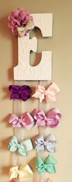You Choose! I will make it for you! These hair bow hangers are made with a wooden letter. I can use any texture of ribbon to display your bows. I usually use a light burlap or a sheer white ribbon. When ordering, please indicate the following: 1. Letter 2. Accent fabric bow color (please state light or dark) 3. Type of ribbon: Tan Burlap or White Sheer Important information: Price for 1 is $20.00 + shipping and handling Bows are not included Letter is approximately 7 inches in height. The…