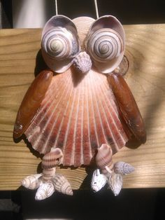Animals of shell on pinterest seashells sea shells and for Animals made out of seashells