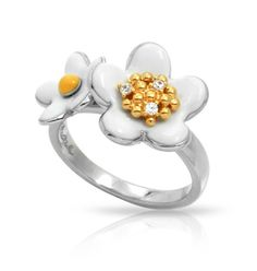 Remember sitting in the grass as a youth, hunting for daisies to string together to make fresh flower jewelry? Featuring beautiful sterling silver links and hand-painted Italian enamel daisy buds with yellow gold-plated pollen and pavé-set stones, the Daisy Chain Collection will always be in bloom. The perfect gift for a childhood friend, mentor, daughter, or even for your own inner child.