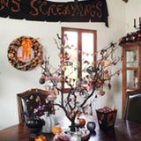 Earlier this month we took a full tour of John Coulter's gorgeous Los Angeles home. During my earlier visit, John was excited to invite me back to see all his fun Halloween decorations. As he happily notes, it's his favorite holiday.