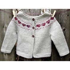 *Little Hearts* is a simple baby cardigan that features a sweet colorwork heart…